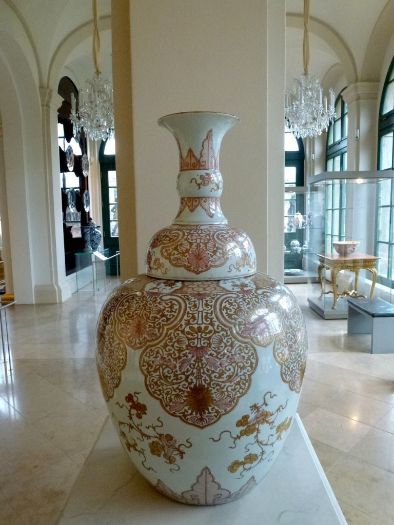 An unique red-and-gold vase in the gallery