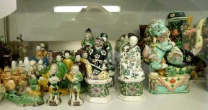 Figures in 'famille verte' on biscuit in storage